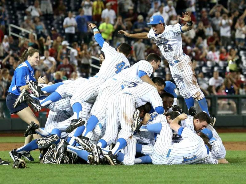 Te UCLA Bruins jump into a pile to celebrate after getting the final out against the Mississippi State Bulldogs during game two of the College World Series Finals at TD Ameritrade Park in Omaha, Nebraska. (AFP)