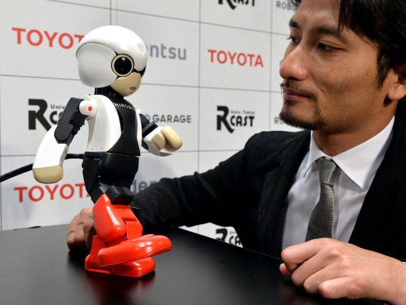Japan's Tokyo University robot creator Tomotaka Takahashi demonstrates a humanoid robot Kirobo which reacts to Takahashi's voice and speaks with gestures in Tokyo. (AFP Photo)