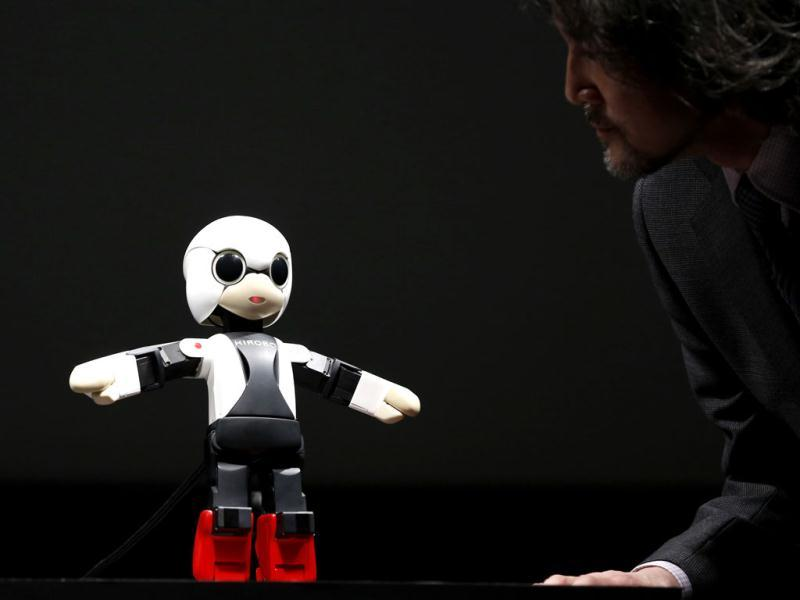 Humanoid communication robot Kirobo talks to Fuminori Kataoka, project general manager in the Product Planning Group of Toyota Motor Corp, during its unveiling in Tokyo. (Reuters)