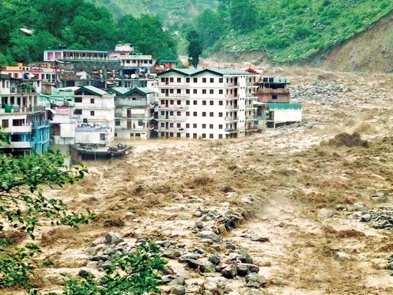 The Govindghat area partly submerged in the flooded Alaknanda river in Chamoli district. (PTI Photo)