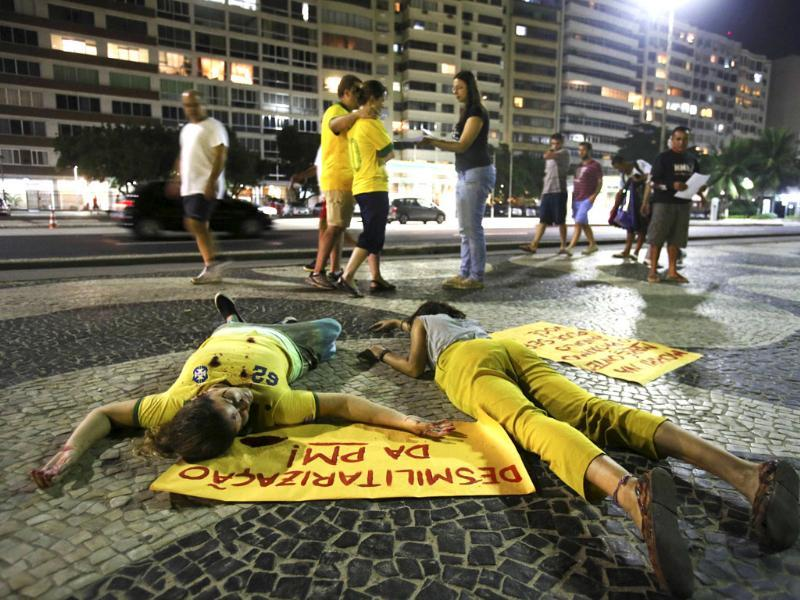Demonstrators lying on the pavement, pretend to be dead during a protest against Brazilian military police at the Copacabana beach in Rio de Janeiro. Reuters