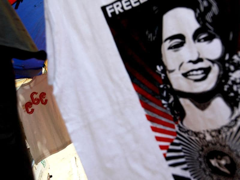 A 969 shirt is seen among National League for Democracy party shirts and Aung San Suu Kyi shirts at a shop on a street side in Yangon. Reuters