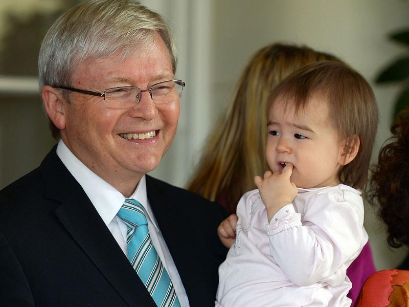 Kevin Rudd holds granddaughter Josephine after he was sworn in as Australia's new prime minister at Government House in Canberra. AFP