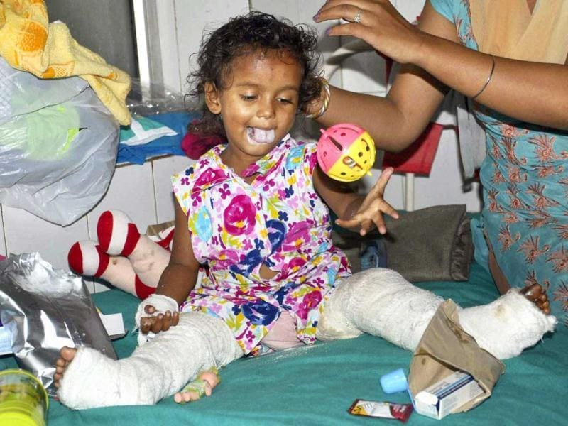 A three year old girl child injured in the flood in Kedarnath admitted in a hospital in Dehradun on Thursday. PTI