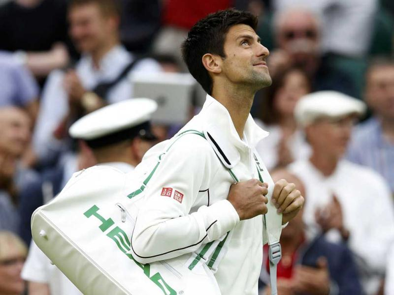 Novak Djokovic of Serbia walks on to Centre Court for his men's singles tennis match against Bobby Reynolds of the U.S. at the Wimbledon Tennis Championships, in London. Reuters