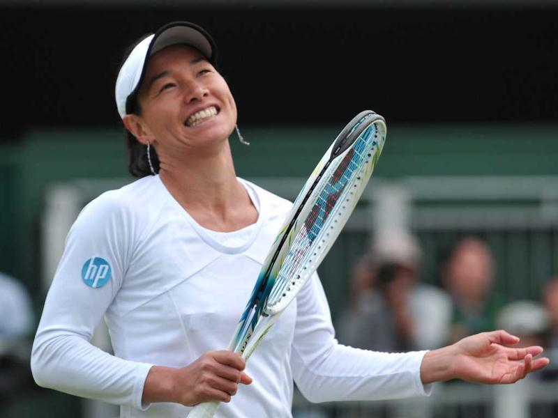 Kimiko Date-Krumm reacts after a point against Romania's Alexandra Cadantu during their second round women's singles match on day four of the 2013 Wimbledon Championships tennis tournament at the All England Club in Wimbledon, southwest London. AFP Photo
