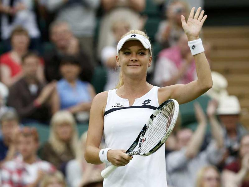Agnieszka Radwanska of Poland celebrates after defeating Mathilde Johansson of France during their women's singles tennis match at the Wimbledon Tennis Championships, in London. Reuters