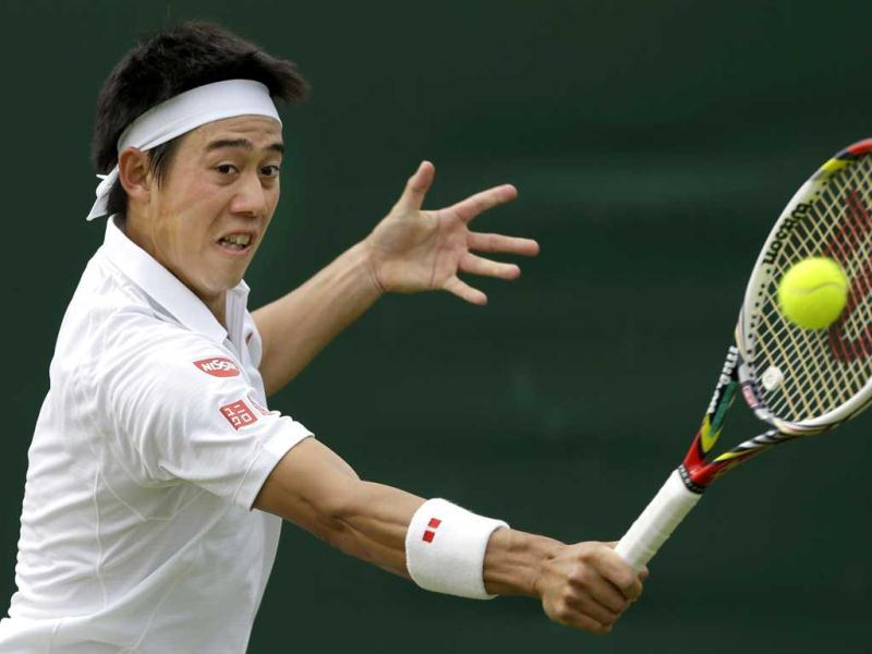 Kei Nishikori of Japan returns to Leonardo Mayer of Argentina during their Men's second round singles match at the All England Lawn Tennis Championships in Wimbledon, London. AP Photo