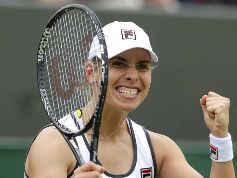 Marina Erakovic of New Zealand celebrates after beating Peng Shuai of China during their Women's second round singles match at the All England Lawn Tennis Championships in Wimbledon, London. AP Photo