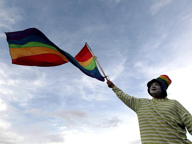 A clown waves a rainbow flag during a lesbian, gay, bisexual and transgender (LGBT) pride parade in Managua. Reuters