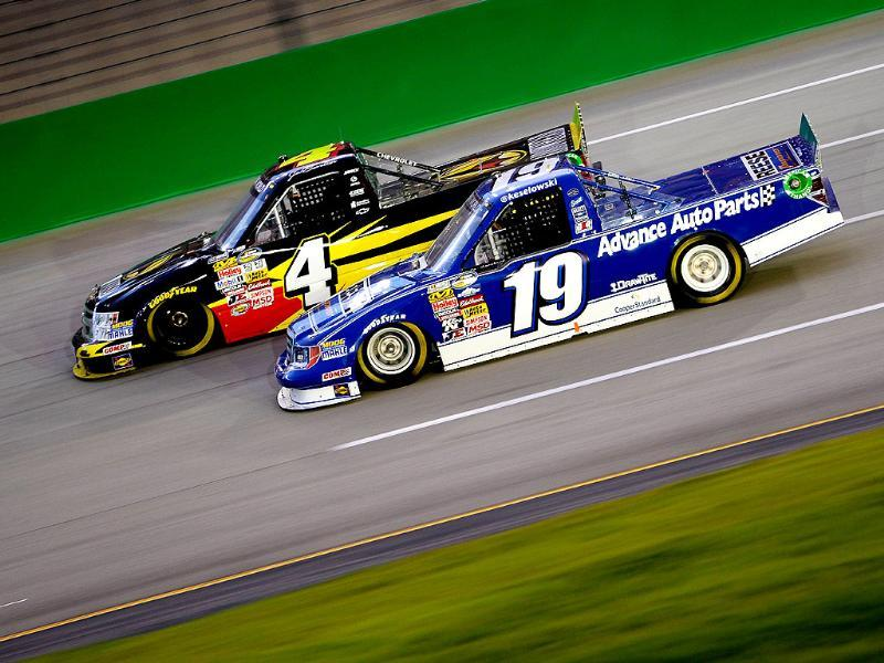 Jeb Burton, driver of the Arrowhead Chevrolet, and Brad Keselowski, driver of the Reese Ford, race during the NASCAR Camping World Truck Series at Kentucky Speedway in Sparta, Kentucky. AFP