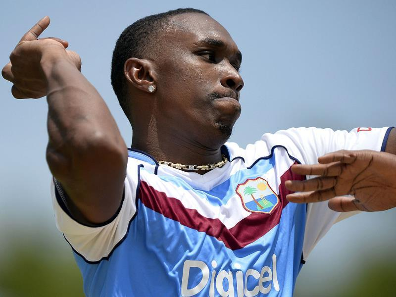 West Indies captain Dwayne Bravo bowls during a practice a session at the Sabina Park stadium in Kingston. AFP