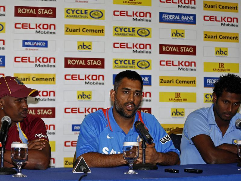 Mahendra Singh Dhoni (C) speaks as his counterparts Angelo Mathews of Sri Lanka (R) and Dwayne Bravo of the West Indies listen during the launch of the Tri-Nation Series in Kingston. AP Photo