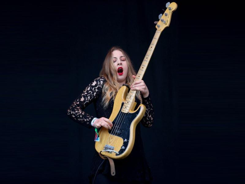 American singer and bass player Este Haim performs in the band Haim on the Pyramid Stage on the third day of the Glastonbury Festival of Contemporary Performing Arts near Glastonbury, southwest England on June 28, 2013. AFP