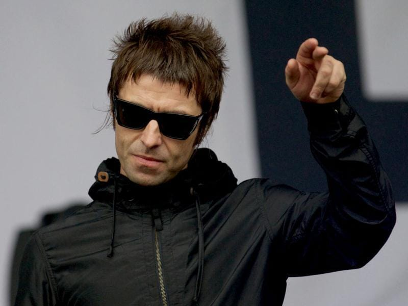 British singer Liam Gallagher gestures to the crowed while performing with his band Beady Eye on third day of the Glastonbury Festival of Contemporary Performing Arts near Glastonbury, southwest England on June 28, 2013. AFP
