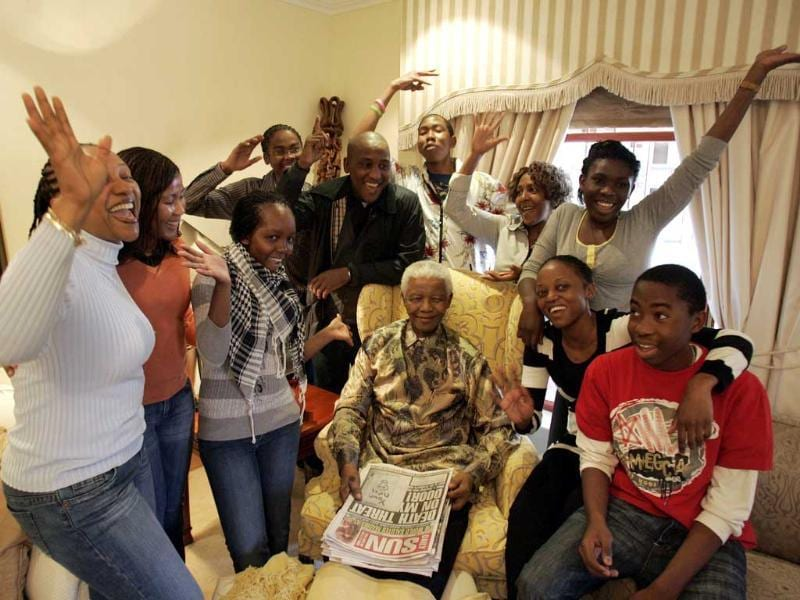 Former South African president Nelson Mandela was admitted with a recurring lung infection. A file phto of Mandela surrounded by his grandchildren at his house in Qunu. AFP