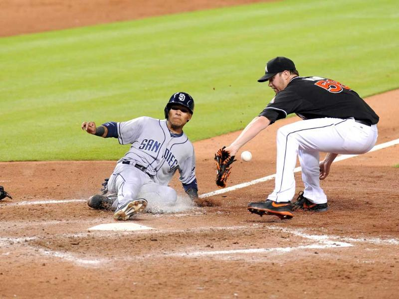 San Diego Padres Alexi Amarista steals home safely on a wild pitch from Miami Marlins during the seventh inning at Marlins Park in Miami, Florida. AFP