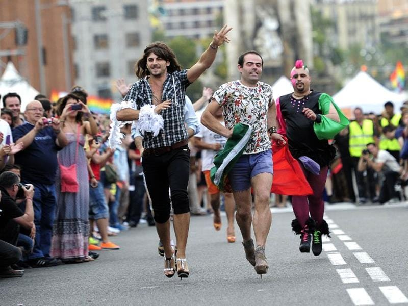Participants take part in a high-heel race during the gay and lesbian pride parade in Barcelona. (AFP)