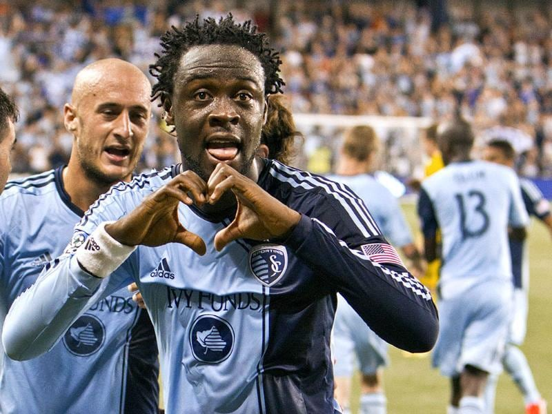 Sporting Kansas City's Kei Kamara shows his love to the fans after he scored his second--and game-winning -- goal in the MLS soccer game against the Columbus Crew in Kansas City. AP