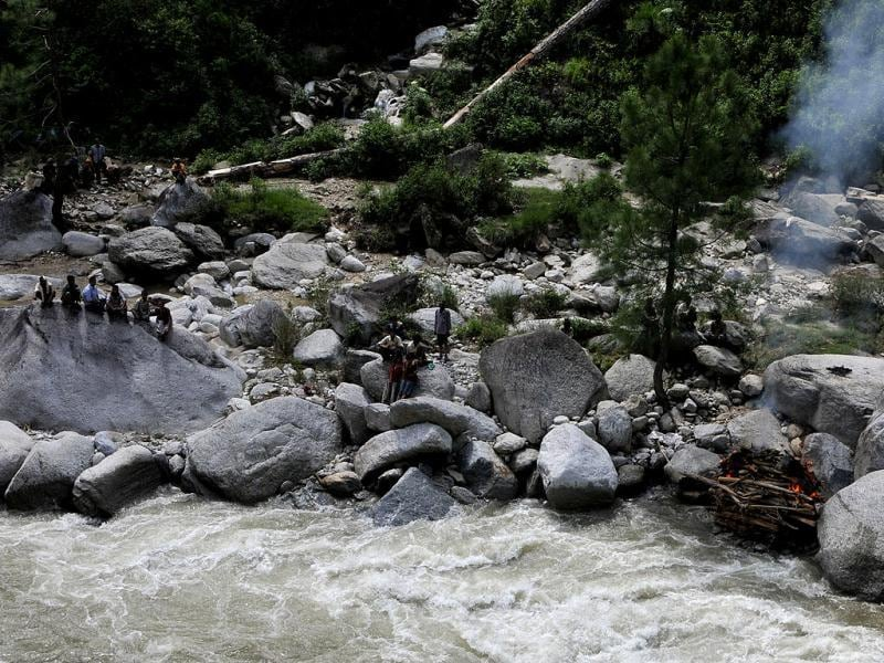 Villagers cremating the body of Laxmi Prasad (48 years) beside a river near Mayali in Uttarakhand. (HT Photo/Arijit Sen)