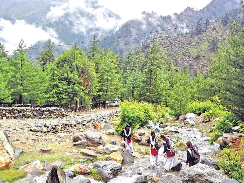 The morning before the floods, school girls from Dharali cross the little stream that empties into Bhagirathi River. (HT Photo/Prasad Nichenametla)