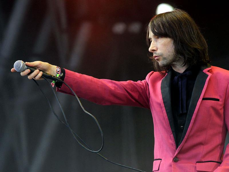 Bobby Gillespie of Primal Scream performs at Glastonbury, England. Thousands are to enjoy the three day festival that started on Friday, June 28, 2013 with headliners, Arctic Monkeys, the Rolling Stones and Mumford and Sons. AP