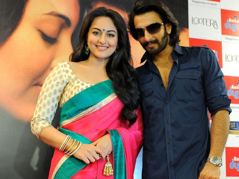 Posing for a picture: Sonakshi Sinha and Ranveer Singh promote Lootera in Ahemdabad. (AFP Photo)