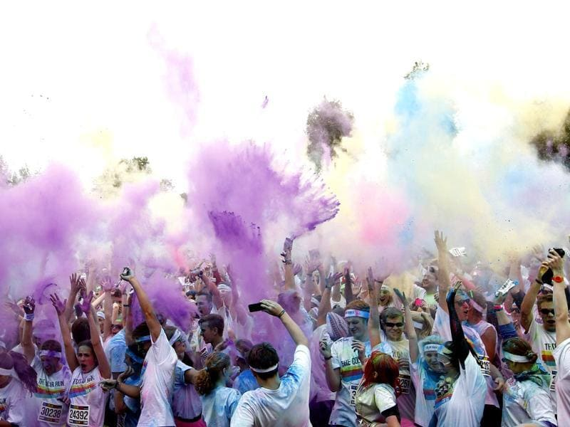 Runners cheer at the finishing line of 'The Color Run' festival in Munich. Reuters