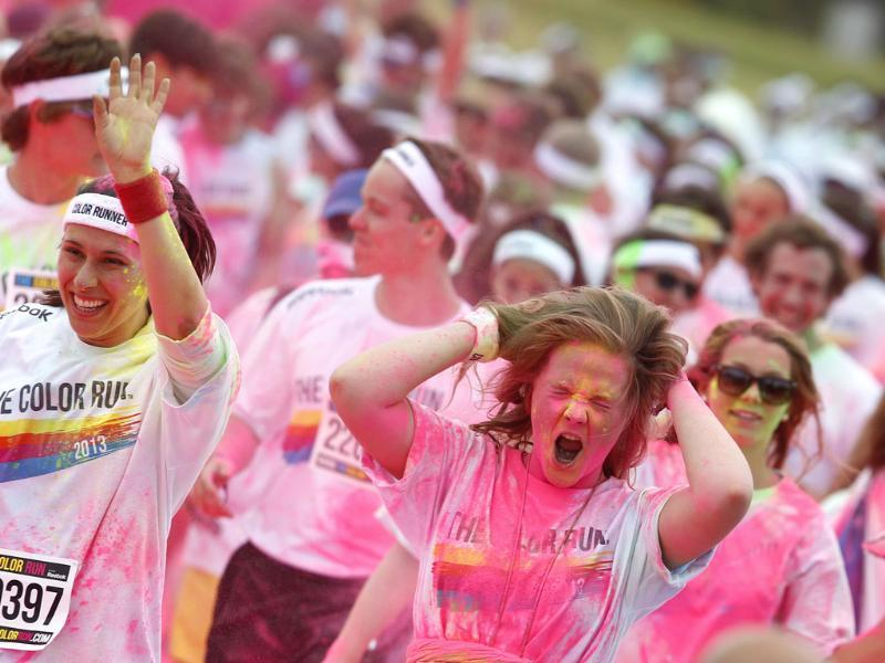 Runners take part in 'The Color Run' Festival in Munich, being covered in blue, pink, orange and yellow powder on their way to the finish line. Reuters