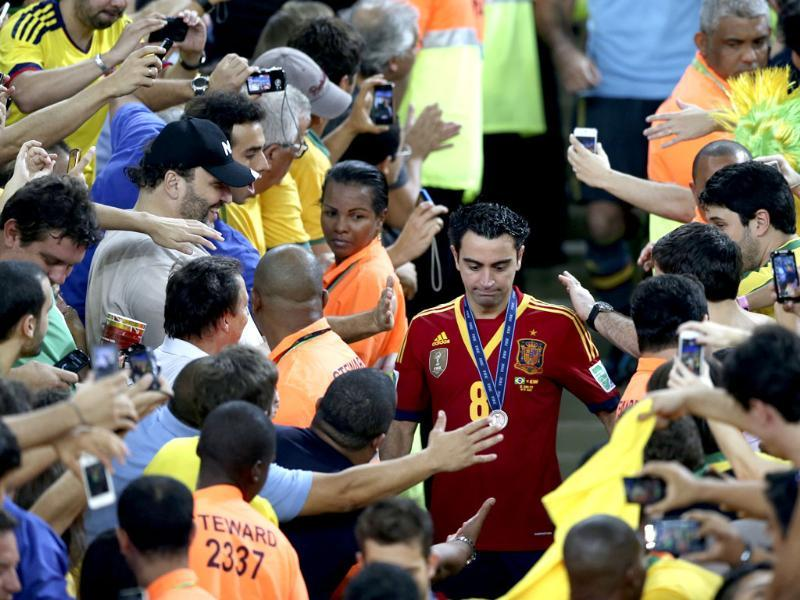 Fans greet Spain's Xavi Hernandez after the soccer Confederations Cup final match against Brazil at the Maracana stadium in Rio de Janeiro, Brazil. Spain lost 0-3. AP