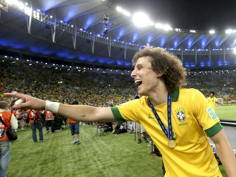 Brazil's David Luiz celebrates after the soccer Confederations Cup final match against Spain at the Maracana stadium in Rio de Janeiro, Brazil. AP