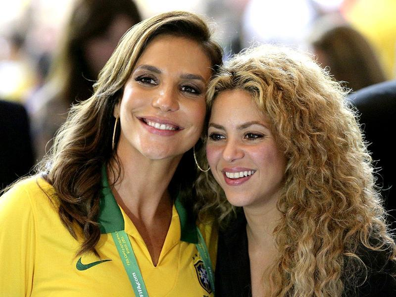 Singer Shakira poses with Brazil singer Ivete Sangalo during the Confederations Cup final match between Brazil and Spain in Rio de Janeiro. Reuters