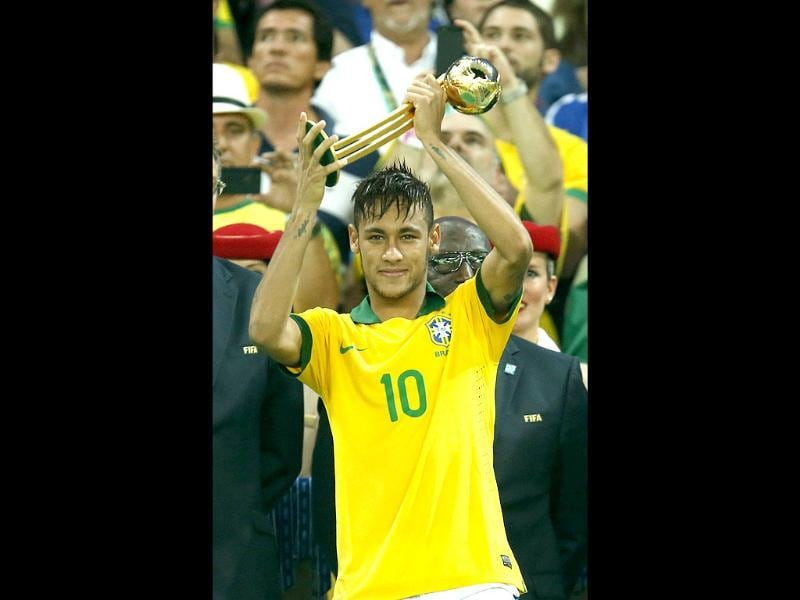 Brazil's Neymar holds the golden ball trophy after Brazil won the Confederations Cup final against Spain at the Maracana stadium in Rio de Janeiro, Brazil. AP