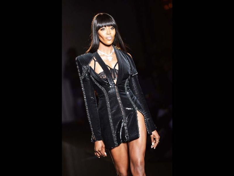 Naomi Campbell in a velvet black coat, along with black shear lingerie and a dazzling Versace pendant. (AFP Photo)