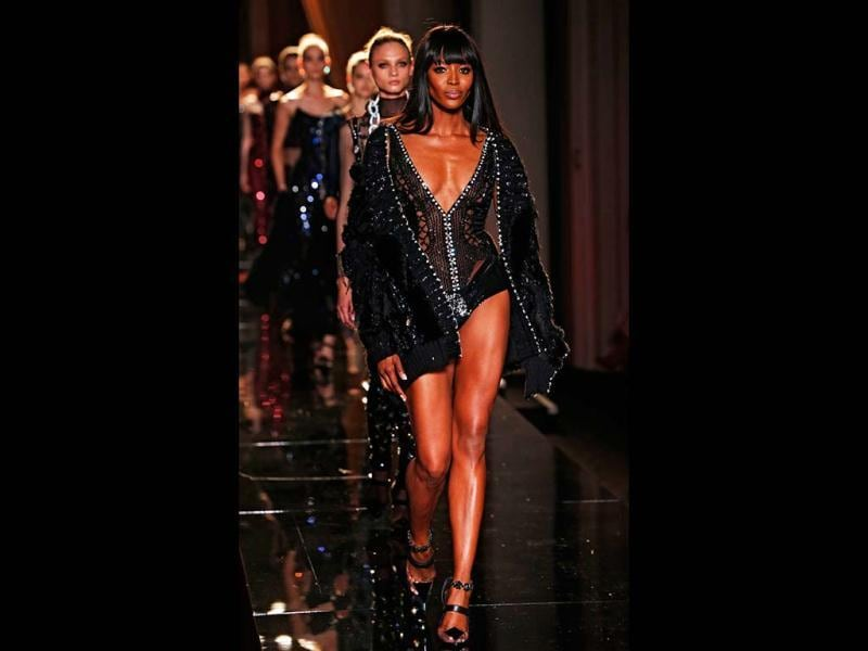 Naomi Campbell flaunts her toned body and lots of skin in a Versace outfit at the Paris Fashion Week. (AP Photo)