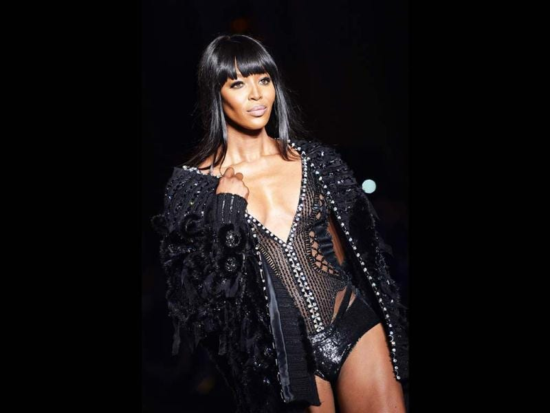 British supermodel Naomi Campbell showed lots of skin as she bared her chest and much more in the net lingerie from Versace's Haute Couture Fall/Winter 2013-2014 collection in Paris. (AFP Photo)