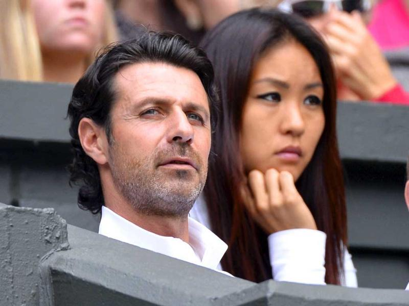 Patrick Mouratoglou, the coach of Serena Williams, sits on Centre Court, during her match with Sabine Lisicki at Wimbledon. Reuters