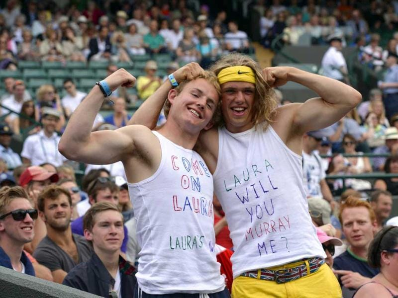Two Robson fans pose for a picture ahead of the Wimbledon fourth round women's singles match between Laura Robson and Kaia Kanepi. AFP Photo