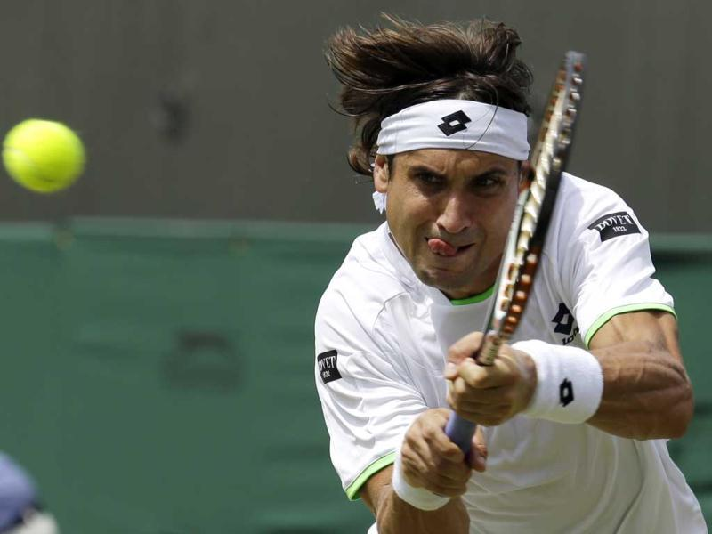 David Ferrer returns to Ivan Dodig in their Wimbledon roung four match in London. AP Photo