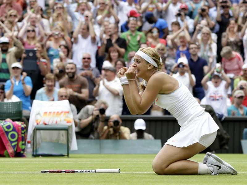Sabine Lisicki reacts after beating Serena Williams at in round four of the Wimbledon tournament in London. AP Photo
