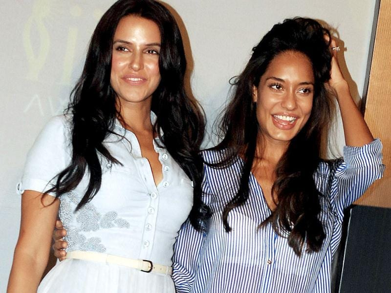 Bollywood actresses Neha Dhupia and Lisa Haydon pose for the shutterbugs as The International Indian Film Academy (IIFA) awards announces major performances at the awards ceremony scheduled to be held in Macau from July 4-6, 2013. (AFP Photo)