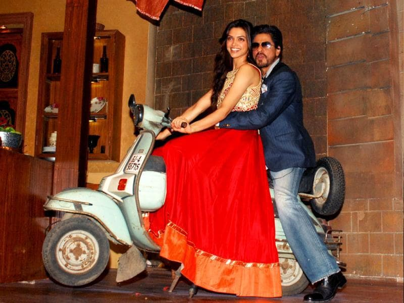 Going to great lengths for the promotion of their upcoming film Chennai Express, Deepika Padukone and Shah Rukh Khan were even seen mounted on a ramshackle scooter on the sets of a TV show. (AFP Photo)