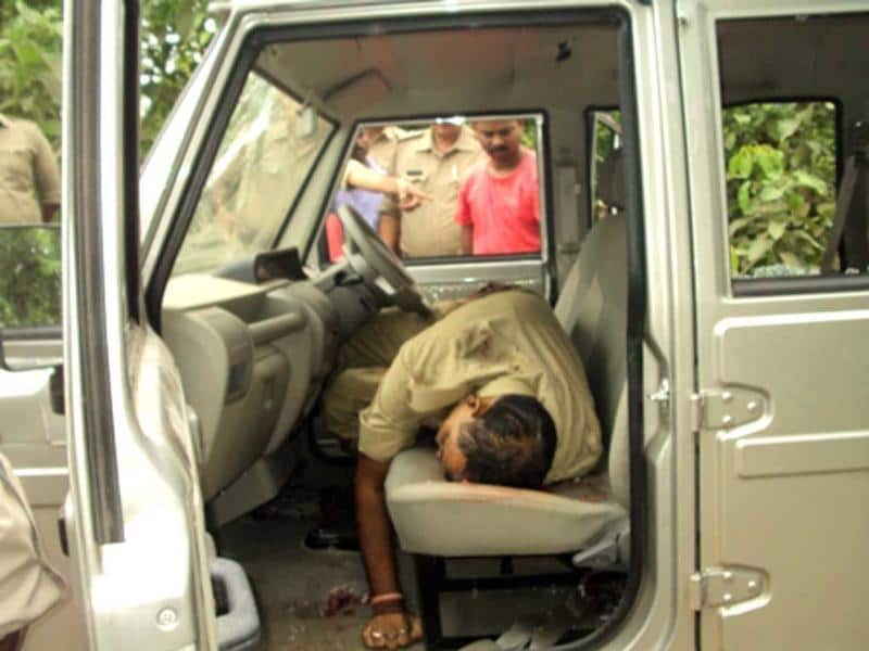 A slain policeman lies in a car after the Maoist attack in the Damini forests, Dumka district of Jharkhand. Hindustan Photo