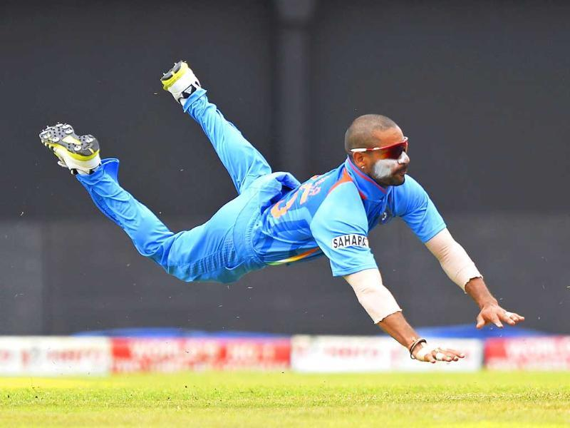 Shikhar Dhawan leaps in the air as he fields a shot during the third match of the Tri-Nation Series between India and Sri Lanka. AFP Photo