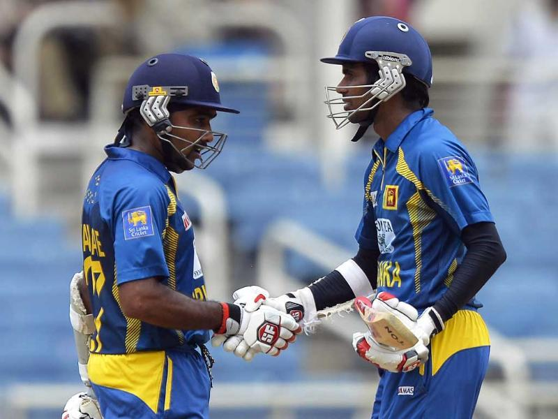 Upul Tharanga is congratulated by teammate Mahela Jayawardene after scoring a half-century during the third match of the Tri-Nation Series between India and Sri Lanka. AFP Photo