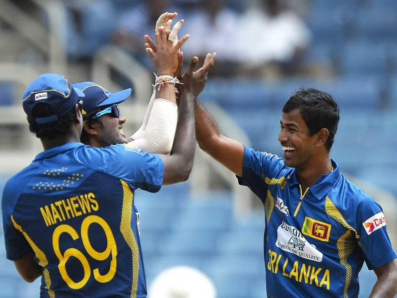 Nuwan Kulasekara celebrates with teammates after dismissing Rohit Sharma during the third match of the Tri-Nation Series between India and Sri Lanka. AFP Photo
