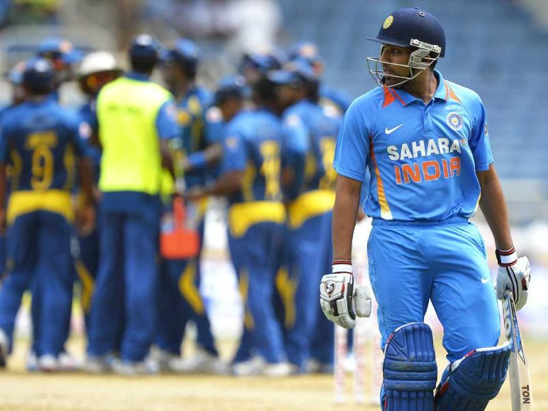 Rohit Sharma leaves the field after being dismised during the third match of the Tri-Nation Series between India and Sri Lanka at Sabina Park. AFP Photo