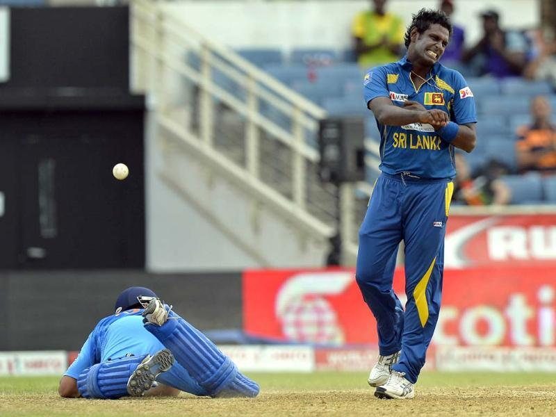 Angelo Mathews reacts after running out Suresh Raina during the third match of the Tri-Nation Series between India and Sri Lanka at the Sabina Park stadium in Kingston. AFP Photo