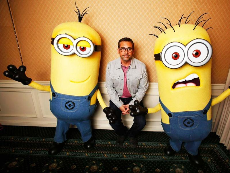 Actor Steve Carell poses with two life-size minion characters while promoting his upcoming movie