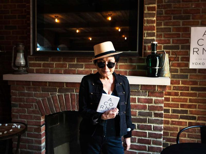 Yoko Ono poses for a photograph while promoting her new book